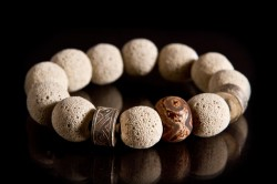 EM112010-43: Cream lava beads with 2 silver Afghan spacers, and Tibetan etched agate bead